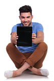 Man showing the blank screen of his tablet pad Royalty Free Stock Photos