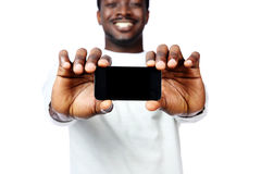 Man showing a blank smartphone display Royalty Free Stock Images