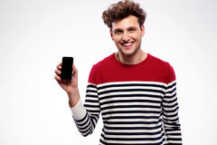 man showing a blank smartphone display Stock Image