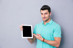 Man showing blank tablet computer screen Stock Images