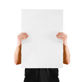 Man showing blank white big A2 paper, covers the face. Leaflet presentation Stock Photo
