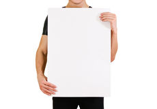 Man showing blank white big A2 paper. Leaflet presentation. Pamphlet. Hold hands. Man show clear offset paper. Sheet template. Booklet design sheet display read royalty free stock photos