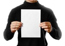 Man showing blank white flyer brochure booklet. Leaflet presenta stock photography