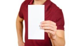 Man showing blank white flyer brochure booklet. Leaflet presentation. Pamphlet hold hands. Man show clear offset paper. Sheet. Template. Booklet design sheet stock photo