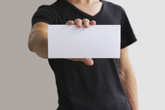 Man showing blank white flyer brochure booklet. Leaflet presentation. Pamphlet hold hands. Man show clear offset paper. Sheet temp Stock Images