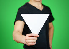 Man showing blank white triangular flyer brochure booklet. Leaflet presentation. Pamphlet hold hands. Man show clear offset paper. Sheet template. Booklet royalty free stock photo