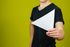 Man showing blank white triangular flyer brochure booklet. Leaflet presentation. Pamphlet hold hands. Man show clear offset paper. Sheet template. Booklet royalty free stock image