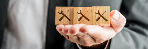 Man Showing Blocks with Service Tools Prints Royalty Free Stock Photography