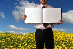 Man showing a book with blank pages Royalty Free Stock Photos