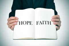Man showing a book with the words hope and faith Royalty Free Stock Images