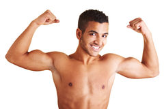 Man showing both arm muscles. A young man flexing his biceps muscles Royalty Free Stock Images