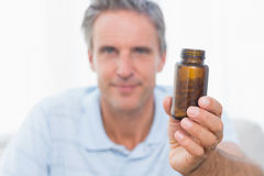Man showing bottle of pills to camera Stock Image