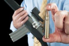 Man showing bullet stock photo