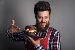 Man showing burger Stock Photo