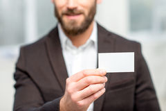 Man showing business card Stock Image