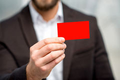 Man showing business card Stock Photo