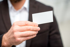 Man showing business card Royalty Free Stock Photography