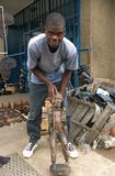 A man showing a carved wooden sculpture, Malawi. Royalty Free Stock Photography