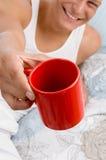 Man showing coffee mug Royalty Free Stock Image