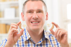Man showing deaf aids. Man showing deaf aid in ear stock photos