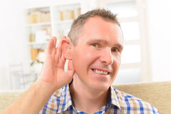 Man showing deaf aids Stock Images