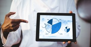 Man showing digital tablet with pie chart on screen Stock Image