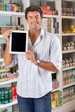Man Showing Digital Tablet In Supermarket Stock Photo