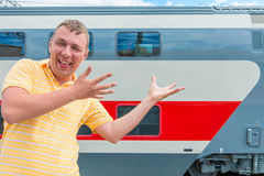 Man showing on the double-decker train Royalty Free Stock Photos