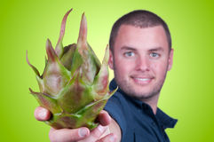 Man showing dragon fruit Stock Photography