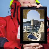 Man showing Dubrovnik in Croatia on tablet. Stock Images