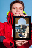 Man showing Dubrovnik in Croatia on tablet. Travel. Royalty Free Stock Images