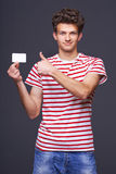 Man showing empty blank paper card sign Stock Image