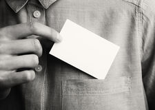 Man showing empty business card. Adult businessman takes out blank Card from the pocket of his shirt. Ready for your Stock Images