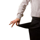 Man showing empty pocket. A businessman pulling out his empty pocket Royalty Free Stock Photo