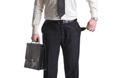Man showing an empty pocket. A businessman showing an empty pocket isolated on a white background Stock Images