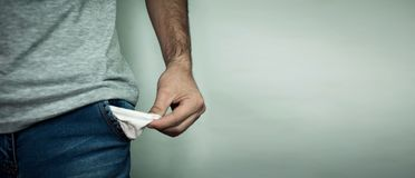 Man showing empty pocket. No money Royalty Free Stock Photos