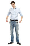 Man showing empty pockets. Young man showing empty pockets Royalty Free Stock Image