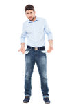 Man showing empty pockets Royalty Free Stock Photo