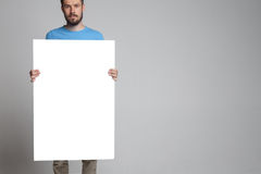 The man showing empty white billboard or banner Royalty Free Stock Images