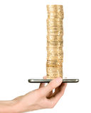 Man is showing golden coins through mobile phone Royalty Free Stock Photos