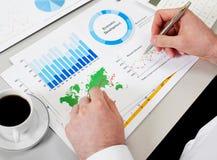 Man showing graph and charts. Closeup Stock Image