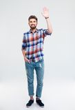 Man showing greeting gesture  Royalty Free Stock Images