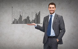 Man showing growing chart on the palm of his hand Stock Photo