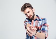 Man showing gun gesture with hands Stock Images