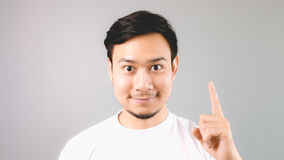 A man showing hand sign the first thing. Stock Image