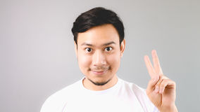 A man showing hand sign second thing. Royalty Free Stock Photo