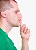 Man showing hand silence sign Stock Photos