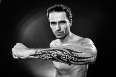Man showing hand with tatoo made in studio Royalty Free Stock Photo