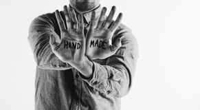 Man showing handmade word on his hands. Royalty Free Stock Image