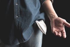 Man showing has no money by turning out the pocket. Empty pocket stock image